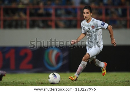 CHONBURI,THAILAND-SEPTEMBER18:Ali Ghalioum of Al Shorta (SYR) contols the ball during the AFC CUP quarter finals between Chonburi fc.and Al Shorta (SYR) at Chonburi Stadium on Sep18,2012 in Thailand - stock photo