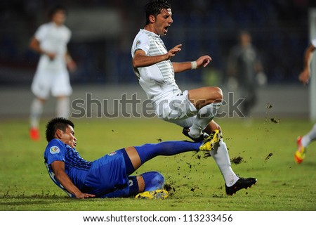 CHONBURI,THAILAND-SEPTEMBER18:Cholratit Jantakam(blue)of Chonburi fc. in action during the AFC CUP quarter finals between Chonburi fc.and Al Shorta(SYR)at Chonburi Stadium on Sep18,2012 in Thailand