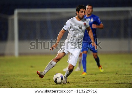 CHONBURI,THAILAND-SEPTEMBER18:Mahmoud Khadouj(white)of Al Shorta (SYR)for the ball during the AFC CUP quarter finals between Chonburi fc.and Al Shorta(SYR)at Chonburi Stadium on Sep18,2012 inThailand - stock photo