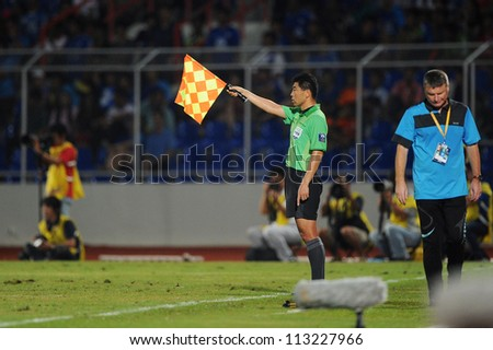 CHONBURI,THAILAND-SEPTEMBER 18:Unidentifie assistant referee  in action during the AFC CUP quarter finals between Chonburi fc.and Al Shorta (SYR) at Chonburi Stadium on Sep18,2012 in Thailand - stock photo