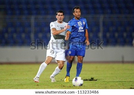 CHONBURI,THAILAND-SEPTEMBER18:Zaher Midani(white)of Al Shorta(SYR)for the ball during the AFC CUP quarter finals between Chonburi fc.and Al Shorta(SYR)at Chonburi Stadium on Sep18,2012inThailand - stock photo
