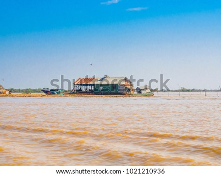 Chong Kneas - Colorful floating Village in Tonle Sap lake in Cambodia