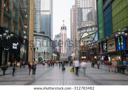Chongqing,China - April 8, 2014: People walking in Business center of Chongqing, Chongqing is the largest direct-controlled municipality and comprises 19 districts, 15 counties and 4 counties. - stock photo