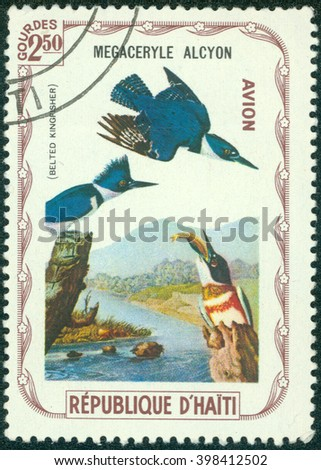 CHONGQING, CHINA - December 20, 2014:A stamp printed in Haiti shows Belted kingfisher, series devoted to the birds, circa 1975 - stock photo