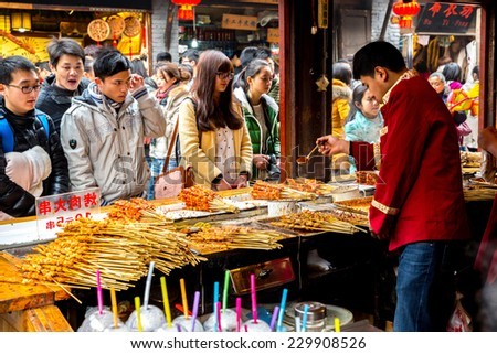 CHONGQING, CHINA - JAN 17: Unidentified merchants are selling traditional food on January  17, 2014 at Ciqikou Ancient Town, Chongqing, China. - stock photo