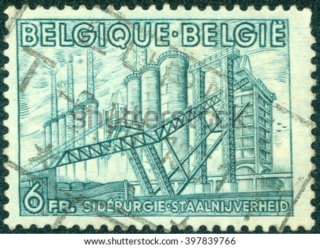 CHONGQING, CHINA - January 7, 2015:A stamp printed by Belgium, shows Iron Manufacture, circa 1948 - stock photo
