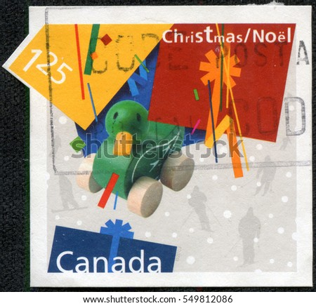 CHONGQING, CHINA - May 11, 2014:A stamp printed in Canada shows image of a toy duck at Christmas time, series, circa 2002