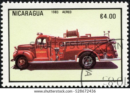 CHONGQING, CHINA - May 10, 2014:A stamp printed in Nicaragua shows firetruck, series, circa 1983