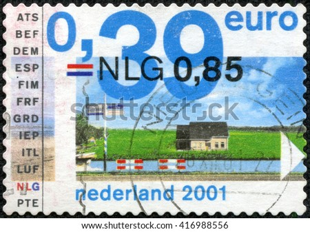 CHONGQING, CHINA - May 9, 2014:A stamp printed in the Netherlands shows a rural house. The water channel, circa 2001. - stock photo