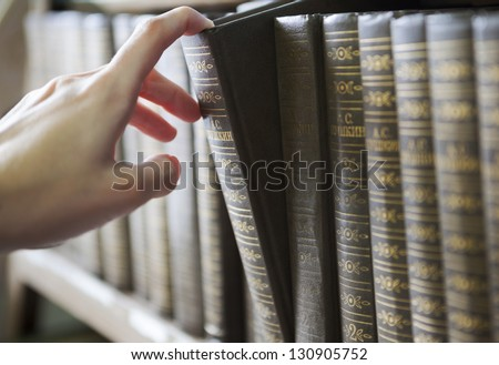 choose books from the shelf - stock photo