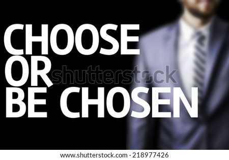 Choose or Be Chosen written on a board with a business man on background - stock photo