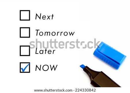 Choosing between now tomorrow next later - stock photo
