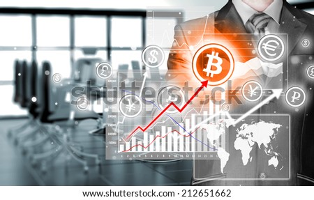 Choosing bitcoins, businessman pressing touch screen button. - stock photo