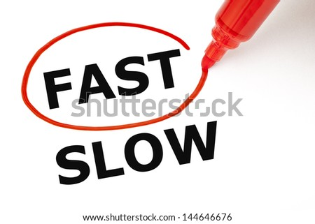 Choosing Fast instead of Slow. Fast selected with red marker. - stock photo