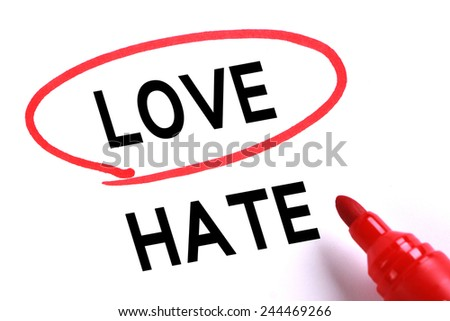Choosing Love instead of Hate with red marker. - stock photo