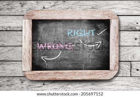 Choosing Right way instead of Wrong way,conceptual on blackboard. - stock photo