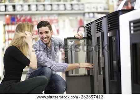 choosing stove - stock photo