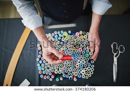 Choosing threads - stock photo