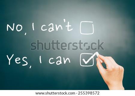 Choosing yes, I can in a blackboard.  - stock photo