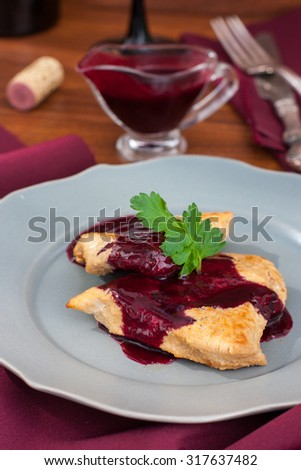 Chop the turkey with red blackcurrant sauce