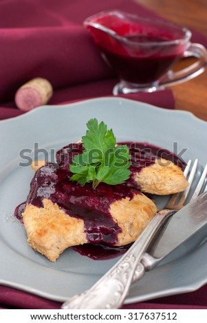 Chop the turkey with red blackcurrant sauce - stock photo
