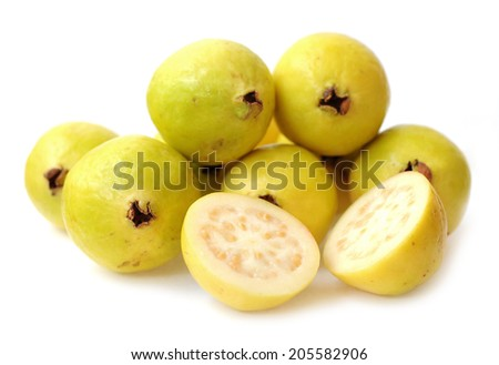 chopped and whole guava on white  - stock photo