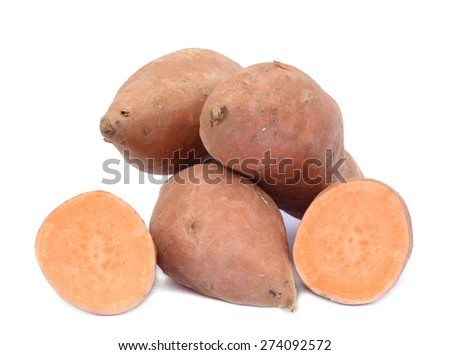 chopped and whole sweet potato  on white background