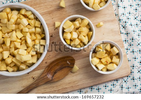 Chopped apples with sugar and spices in baking dishes. - stock photo