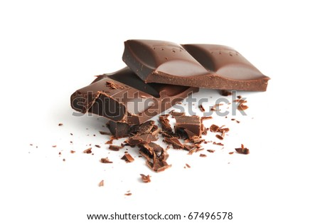 Chopped black chocolate with grit isolated on white - stock photo