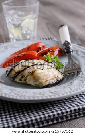 Chopped capsicum and eggplant, grilled and served on a plate - stock photo