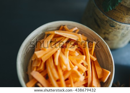 chopped carrot on dish for prepared food image