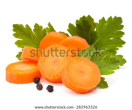 Chopped carrot slices and parsley herb leaves still life isolated on white background cutout - stock photo