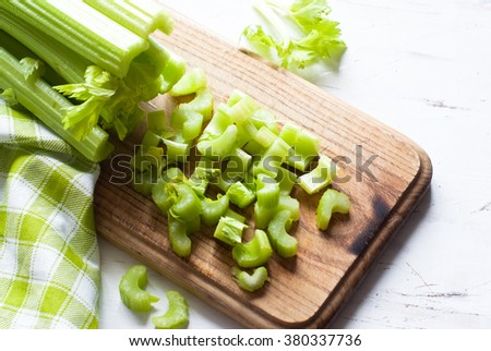 Chopped Celery stalks on a cutting board. Healthy food. - stock photo
