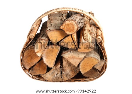 chopped firewood in wicker basket on a white background - stock photo