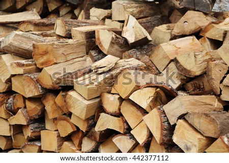 Chopped firewood stacked into a pile - stock photo