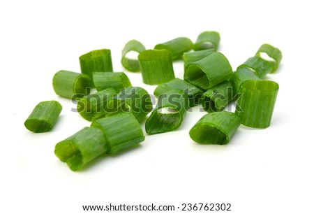 chopped green onions on white