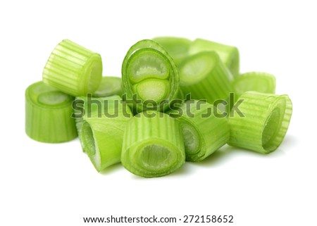 chopped green onions on white background - stock photo