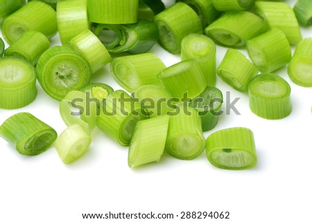 chopped green onions on white background