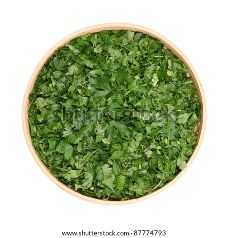 chopped leaves of fresh herbs, parsley, dill, cilantro, basil, in dereyannoy bowl isolated white background - stock photo