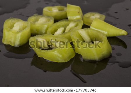 Chopped pepper on the black plate in the kitchen.  - stock photo