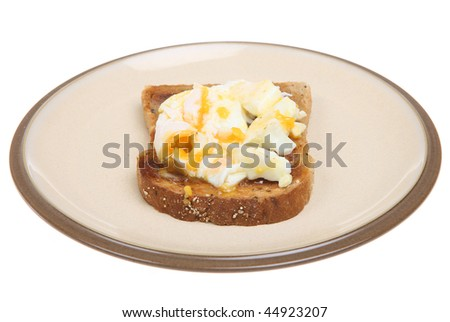 Chopped poached egg on wholemeal toast
