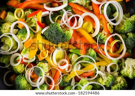 chopped raw vegetables in a frying pan close-up - stock photo