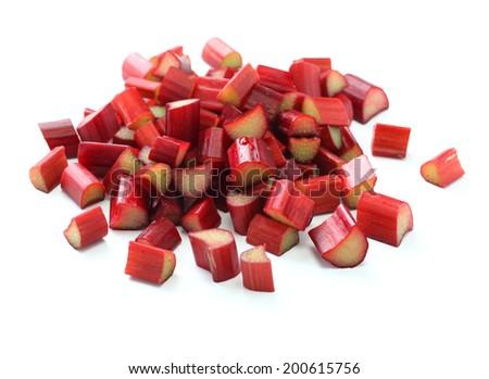 chopped red rhubarb on white background - stock photo