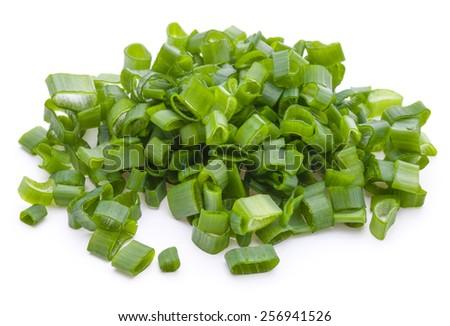 chopped spring onion or scallion isolated on white background cutout - stock photo