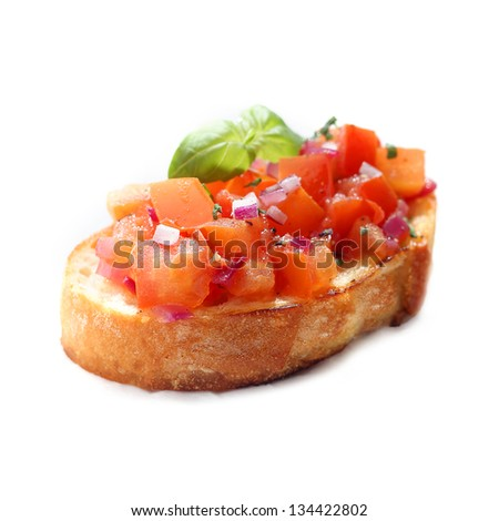 Chopped tomato and onion bruschetta, an Italian antipasta served on grilled or toasted crispy crusty sliced baguette, on a white background - stock photo