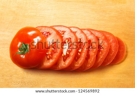 chopped tomato on wooden cutting board