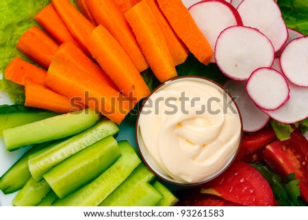 Chopped vegetables and sauce on plate closeup - stock photo