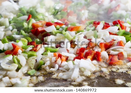 chopped vegetables frying in oil - stock photo