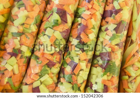 Chopped vegetables - mix - packed in plastic bag - sale of organic products - stock photo