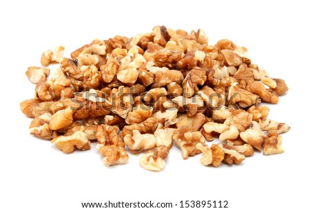 Chopped walnuts, isolated on a white background - stock photo
